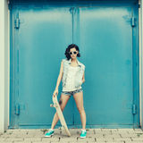 Young brunette woman posing with skateboard Stock Image