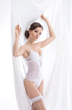 A young brunette woman posing in white lingerie Royalty Free Stock Image