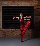Young brunette woman in red dancing Royalty Free Stock Photos