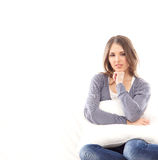 A young brunette woman relaxing in a blue sweater Stock Photography