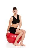 Young brunette woman resting on exercise ball Stock Photo