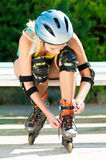 Young brunette woman on roller skates Royalty Free Stock Images