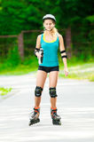 Young brunette woman on roller skates Stock Image
