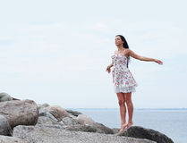 A young brunette woman on a sea background Stock Photos