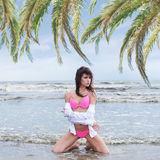 A young brunette woman on a sea resort background Stock Images