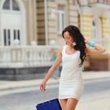 Young brunette woman with shopping bag Stock Photo