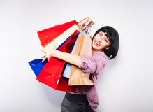 Young brunette woman with shopping bags Royalty Free Stock Photos