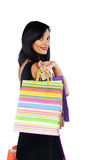 Young brunette woman with shopping bags isolated on white Royalty Free Stock Photography