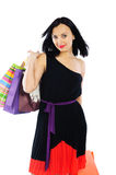 Young brunette woman with shopping bags isolated on white Royalty Free Stock Photos