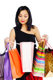 Young brunette woman with shopping bags isolated on white Royalty Free Stock Images