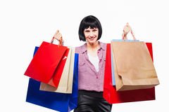 Young brunette woman with shopping bags Stock Photos