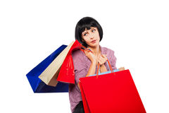Young brunette woman with shopping bags Royalty Free Stock Photo
