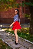 Young woman spinning in the park. girl in red skirt dance outdoor royalty free stock photo
