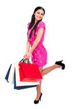 Young brunette woman with some shopping bags Royalty Free Stock Photos