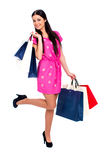 Young brunette woman with some shopping bags Royalty Free Stock Photography