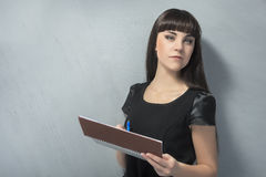 Young Brunette Woman With Spring Notebook Against Grey Wall Stock Images