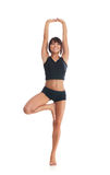 A young brunette woman stretching her muscles Stock Images