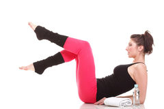 Young brunette woman stretching muscles isolated Royalty Free Stock Photo