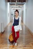 young brunette woman student, female drawing designer artist, in hall of college university, person at work Stock Image