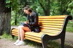 Young brunette woman studying in a park stock image