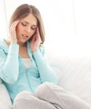 A young brunette woman suffering from a headache Stock Images