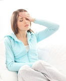 A young brunette woman suffering from a headache Stock Photo