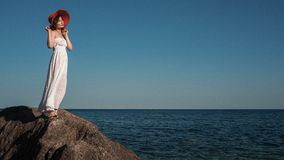 Young brunette woman in summer white dress Stock Images