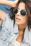 Young brunette woman in sunglasses Stock Photography