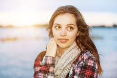 Young brunette woman at sunset. Candid portrait of young brunette woman at sunset looking away with copy space Royalty Free Stock Photography