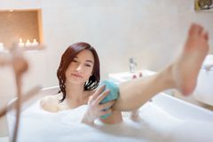 Young brunette woman taking bath Royalty Free Stock Photos