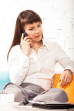 Young brunette woman talking on cell phone Royalty Free Stock Image