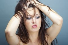 Young brunette woman thinking Stock Photo