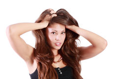 Young brunette woman touches her hair Royalty Free Stock Images