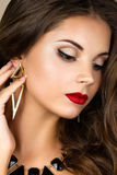 Young brunette woman touching her earring Stock Image