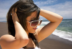 Young brunette woman vacationing on the beach. Young brunette woman vacationing at a Pacific coast beach ocean resort near San Diego, California, USA Royalty Free Stock Photo