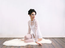 Young brunette woman in wedding lingerie Royalty Free Stock Photography
