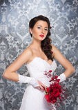 A young brunette woman in a white bridal dress Stock Images