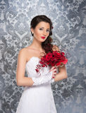 A young brunette woman in a white bridal dress Royalty Free Stock Photo