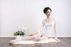 Young brunette woman in white bridal lingerie Royalty Free Stock Images