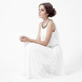Young brunette woman in white dress. White Background. Stock Photography