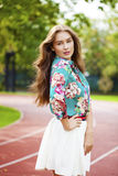Young brunette woman in white skirt Stock Photos