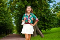 Young brunette woman in white skirt Royalty Free Stock Image