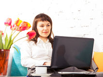 Young brunette woman working at home Stock Photos