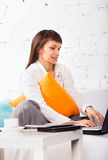 Young brunette woman working at home Stock Photography