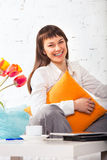 Young brunette woman working at home Royalty Free Stock Image
