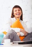 Young brunette woman working at home Stock Photo