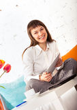 Young brunette woman working at home Stock Image