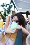Young woman with her dog in cafe bar stock photography