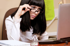 Young brunette working with laptop Stock Photography