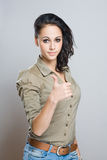 Young brunettewoman showing thumbs up. Royalty Free Stock Images